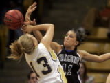 Legacy Lightning's Mara Cosgrove, left, gets blocked by Highlands Ranch's Jaclyn Thoman, right, in...