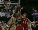 LCM0397  Eaton's Seth Lobato knocks the ball out of Eagles' Jobi Wall's lay up during the third...