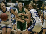 Cedaredge's Katie Wright tries to hold back Machebeuf's Erin Doherty with the help of Katie Eason...