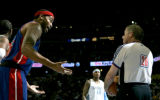 Detroit Pistons Rasheed Wallace argues with referee Bob Delaney in the second period while Denver...