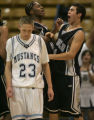 Ralston Valley Mustang Grant Hamilton, left, is dejected as Abraham Lincoln Lancers teammates...