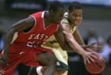 Denver East Angels Blake Swain, left, and Aurora Central Trojans' Stephen Franklin, right, fight...