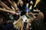 In the 4th period Kent's head coach Todd Schayes rallies his team during the Kent Denver Sun...