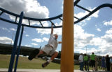 Zach Swadburg, 5,  plays on the monkey bars as his mom, Sherrie Swadburg attends a meeting held by...