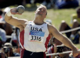 OLYMPIA, GREECE, AUGUST 18, 2004) United States' shot put thrower, Adam Nelson makes his second...