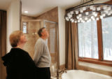 Robert and Lorie O'Neill, from Tennessee, tour the master bathroom of their new HGTV Dream Home...