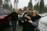 Lorie O'Neill, far right, from Tennessee, hugs Krissy Leto (cq), a media supervisor with GMC, as...