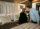 Robert and Lorie O'Neill, from Tennessee, kiss each other in the master bedroom during the taping...