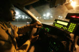 Daniel Negash (cq) a Denver area taxi driver, calls other drivers in the early morning to see...