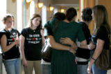 Friends of Chayce Miller (not in photo) gather around his mother Erin Miller, cq, giving her a...