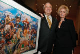 Patrons Al and Sue Provost were the winning bidders on Denver Broncos artwork up for auction at...