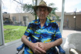 Jim Stone is a resident sitting on the porch at the Julia Temple Center which is a skilled nursing...