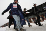 MJM637 The New To Colorado Outdoors Club from Denver take part in the Coffin Races Saturday during...