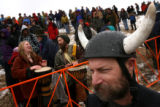 MJM682 Dr. Howard Beckley (cq) of Denver, Colo. sports a viking helmet while watching the Coffin...