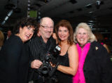 From left, Joan Siler, WonderWorks photographer and inaugural Person of the Year Steve Crecelius,...