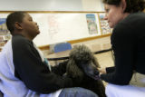 Lisa Lancelot (cq) visits with Matthew Richardson (cq), 13, a 7th grader at Denver's Hill Campus...