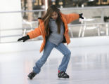 Selena Orr, 10, of Sarasota Florida, enjoys some ice skating at The Rink at Belmar Monday...