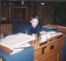 Mark Owens Feb 1990 at Senate desk of dad. Mark, 3, at his dad's desk in the State Senate.