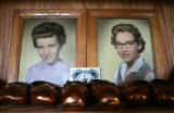 Photographs of Jan Paxton, left, and her sister, Marilyn, share a display case with their bronzed...