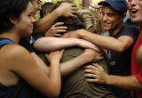 09/03/2004) New York City-A protestor, center, is hugged after being released from Central Booking...