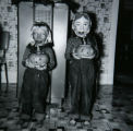 Historical photos of Janet Paxton, left, and Marilyn Paxton, right, on Halloween. Janet and...