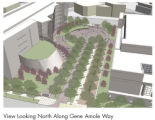 The view looking north along Gene Amole Way into the Justice Center plaza shows the folded plate...