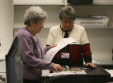 Members of the Weld County Election Canves Board, Pat Jordan, left, and Alice Risk, take part in...