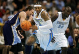 The Denver Nuggets Carmelo Anthony (#15) takes off downcourt with the ball against the Memphis...