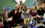 Temple Sinai pre-school teacher Aviva Kelmenson (cq) sings a song about the Menorah with her class...