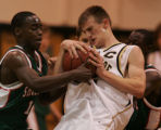 [JPM276]Smoky Hill High School Leon Whittington (13) and Steve Agyei (2) pressure  Arapahoe High...