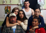 MJM264  Salvador Figueroa, bottom left, sits in the kitchen of his family's Denver home Wednesday...