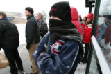 Jenn Ratcliff, cq, braves the cold and snow along with many other RTD riders as they wait in line...
