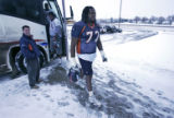 Denver Broncos right tackle George Foster, #72, walks into the Bronco's indoor training facility...