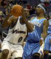 VZN103 - Washington Wizards' Gilbert Arenas (0) drives past Denver Nuggets' J.R. Smith during the...