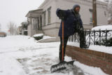 MJM120   David Milton (cq) takes a break from shoveling a sidewalk along 22nd Ave. in the Five...