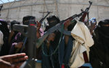 (NYT58) MOGADISHU, Somalia -- Dec. 8, 2006 -- SOMALIA-ETHIOPIA-2 -- A group of women hold up their...