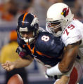 (DENVER, Colorado. September 2, 2004)     Denver Bronco's quarterback, #8, Matt Mauck, left,...