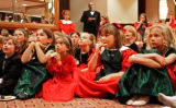 (Denver, Colo., December 1, 2006) Children marvel at a magic show outside the ballroom.  The 2006...