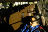 08/16/2004 Denver-Rico Henderson, 7, a second grader at Steck Elementary, rides the bus to his...