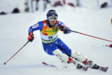 Swiss skier Marc Berthod (#19) makes his way around a gate during the Slalom run of the Visa Birds...