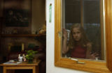 (WESTMINSTER, Colo. August 18, 2004) Breanna,9, poses in the window adjacent to the kitchen where...