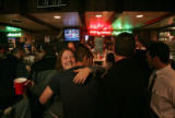 Jodie Becker,(cq) a patron a former waitress hugs friends as a crowd gathers at Duffy's Restaurant...