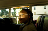 08/16/2004 Denver-Ventika Henderson, 9, a fourth grader at Steck Elementary, rides the bus to his...