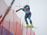 U.S. skier Steven Nyman (#8) gets a bit twisted as he flies off the Red Tail Jump during the Visa...