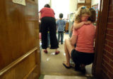 08/16/2004 Denver-Heidi Masters comforts her daughter Grace, 4, before leaving her for her first...