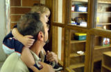 08/16/2004 Denver-Wyatt Mandeau, 2, sits on his father Robert's shoulders while peering into the...