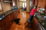Wes Naake, 2, plays in the kitchen of his Park Hill house.  Builder Steve Luber (cq) of Denver...