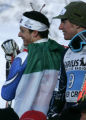 First place finisher Massimilliano Blardone (left) shows off his Italian flag as he celebrates...