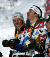 First place finisher Massimilliano Blardone (center) lets the champagne fly as he celebrates...