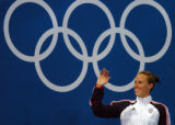 (ATHENS, GREECE-AUGUST 19, 2004)  United State's gold medal winner, Amanda Meard, waves to someone...